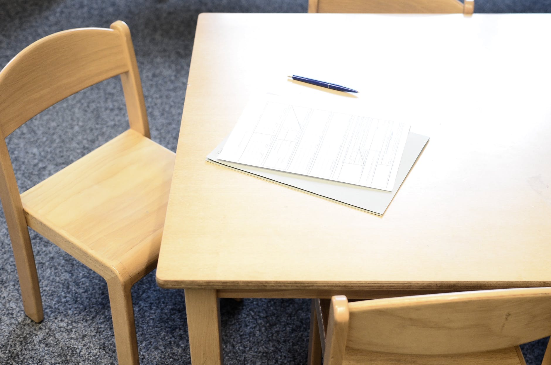 application sheet with pen on table in building
