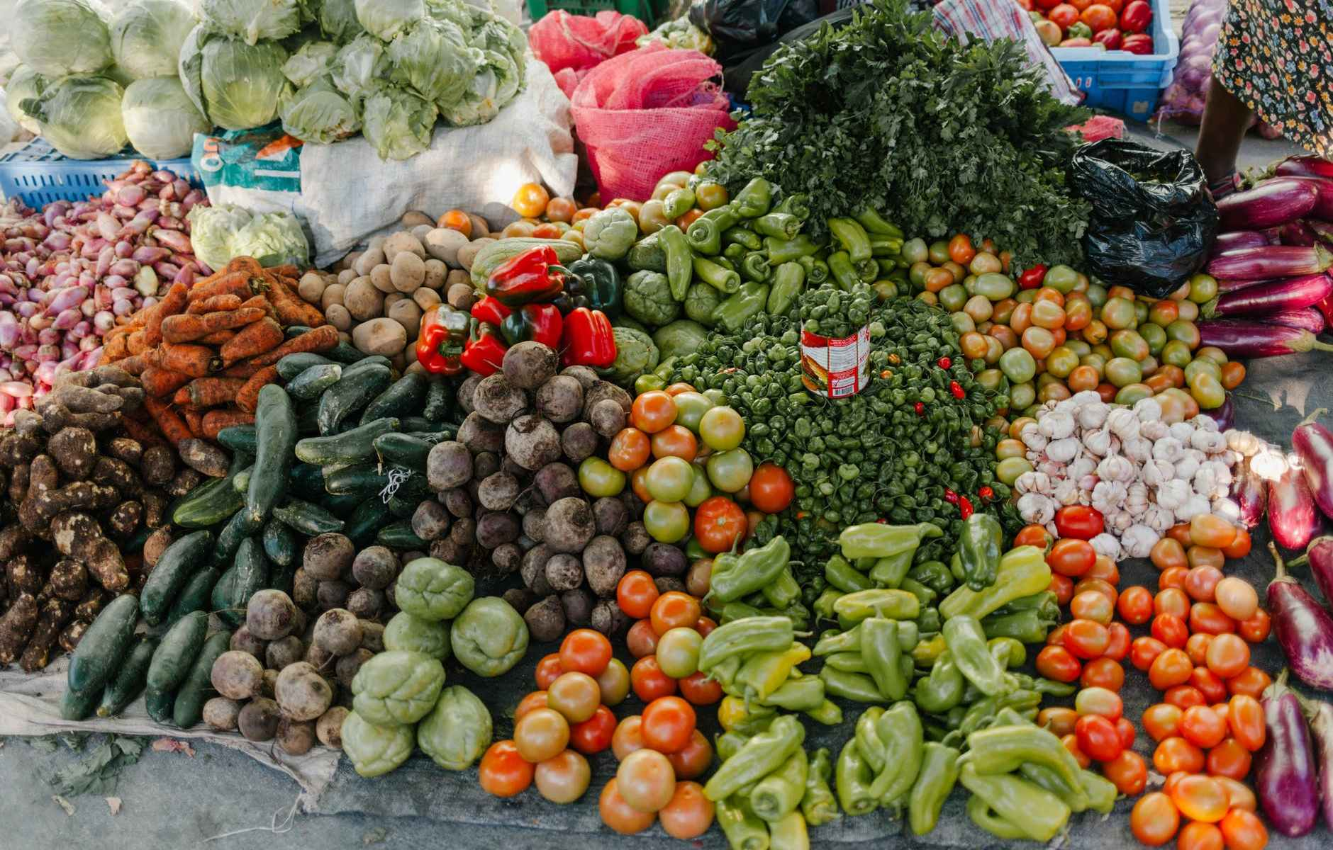 different vegetables in pile at street market