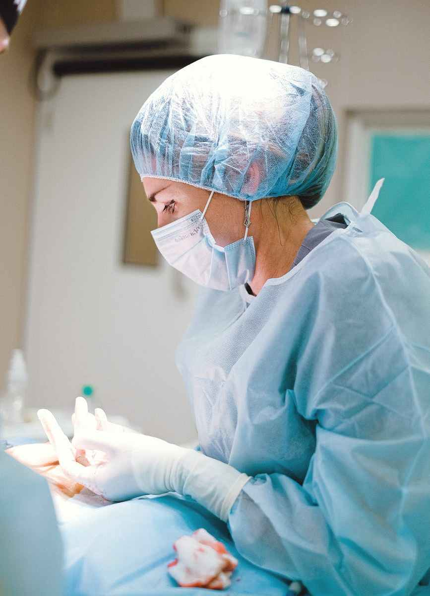 female doctor in blue scrub suit