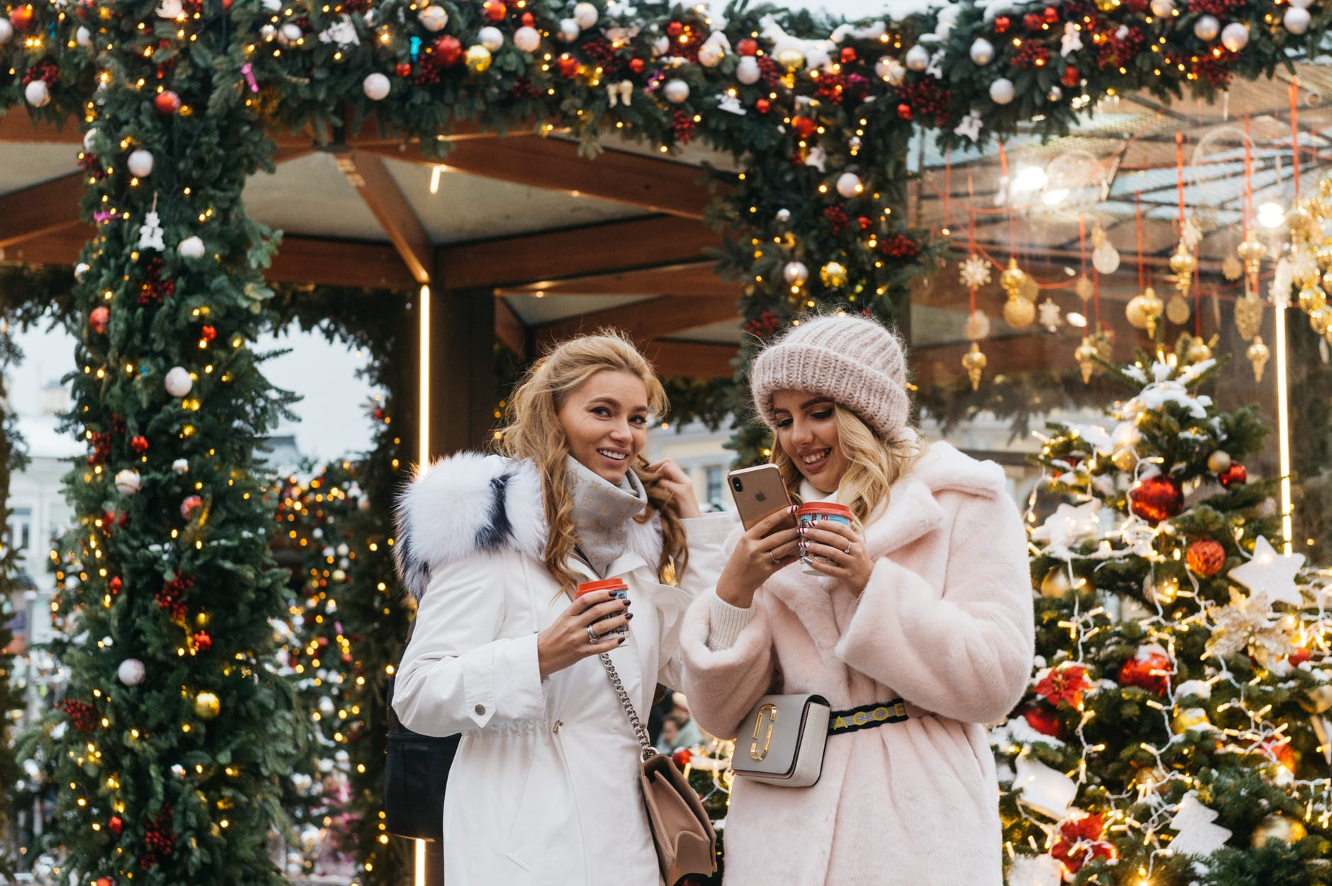 two women near christmas decorations