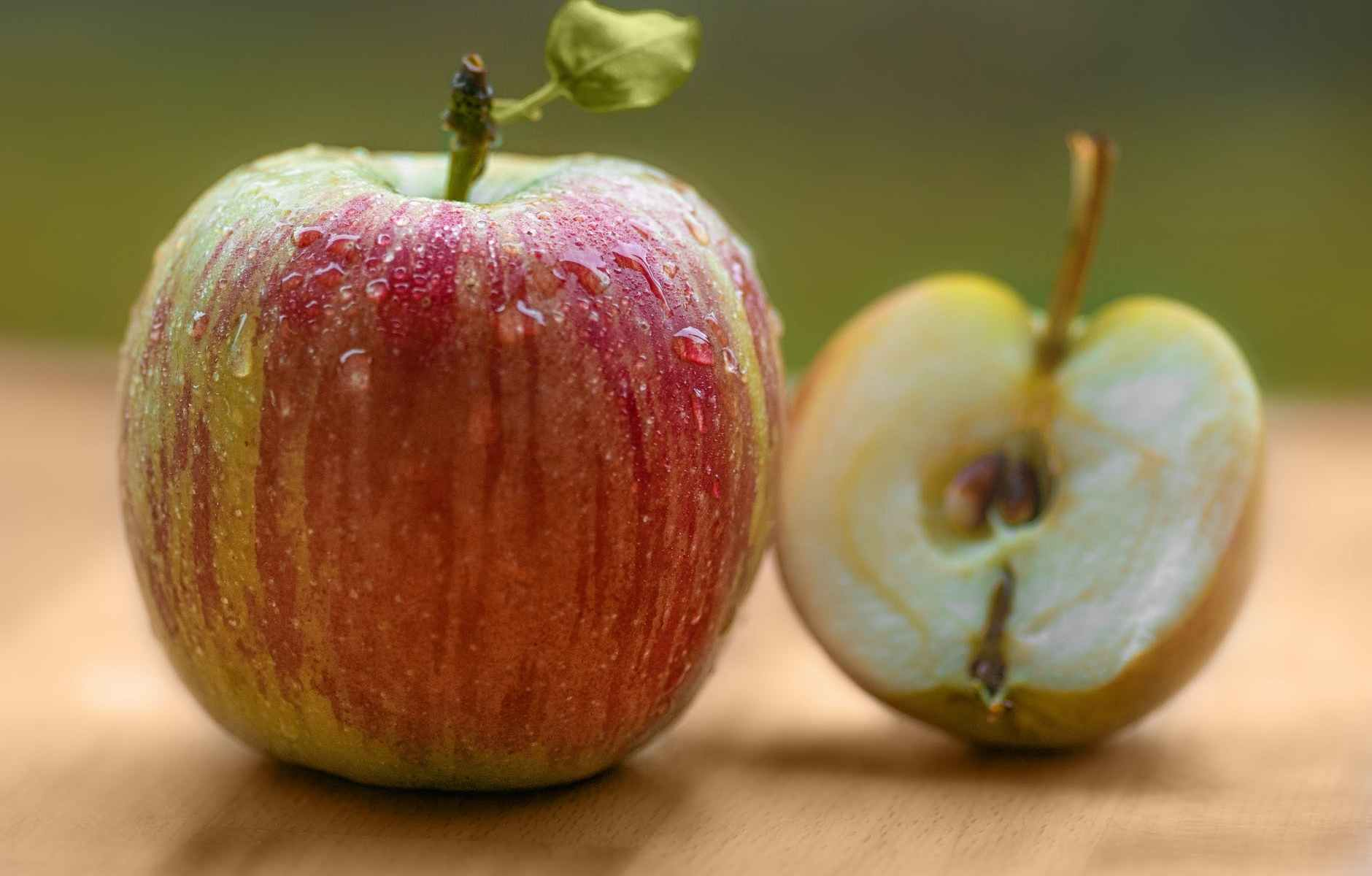 red and green apples on brown surface