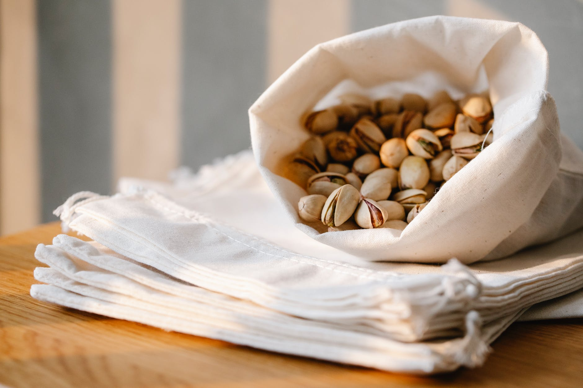 sack of pistachios on table