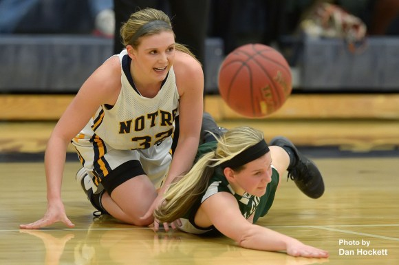 Photo by Dan HockettNotre Dame's Taylor Hickey (left) and West Burlington's Kaylee Dotcherman (right) collide fighting for the ball during Friday night's game in Burlington. Notre Dame defeated West Burlington, 84-25.
