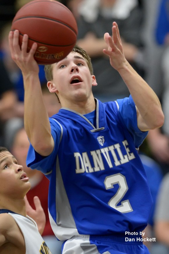 Photo by Dan Hockett Danville's Connor Hogberg (2) goes to the basket around Notre Dame's Xavier Williams (left) during Thursday night's game at Father Minett Gymnasium in Burlington. Danville defeated Notre Dame, 83-46.