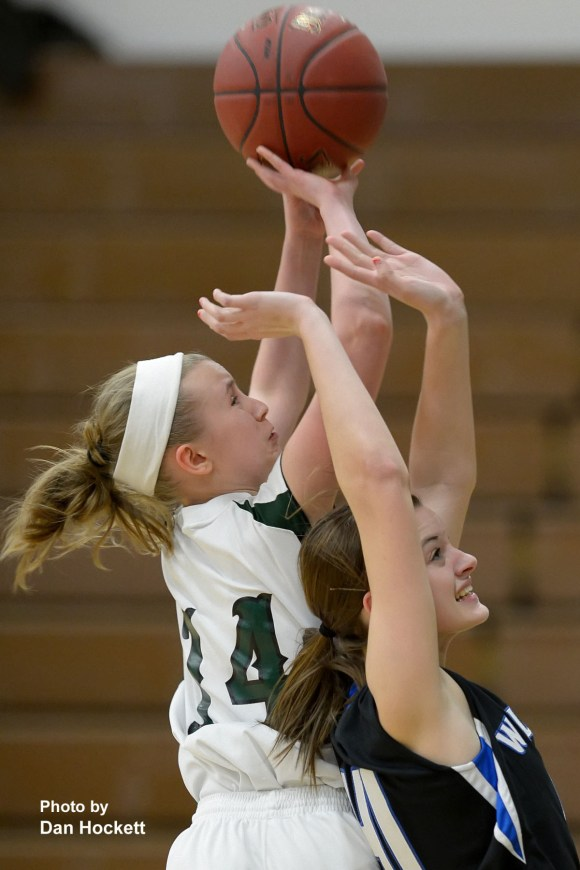 Photo by Dan HockettWest Burlington's Darien Ringold is fouled going to the basket by Columbus' Caitlin Chaney during Monday night's game in West Burlington. Columbus defeated West Burlington, 74-37.