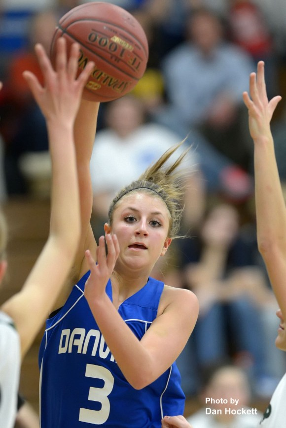 Photo by Dan HockettDanville's Lindsay Schaffer passes the ball to a teammate against West Burlington Tuesday night in West Burlington. Danville defeated West Burlington, 58-36.