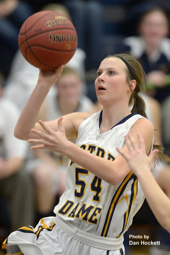 Photo by Dan Hockett Notre Dame's Gabrielle Koelker goes to the basket against Danville in second round regional play at Father Minett Gymnasium in Burlington. Notre Dame defeated Danville, 75-35.