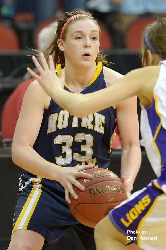Photo by Dan Hockett Notre Dame's Taylor Hickey looks to drive around a Central Lyon defender in the Class 1A Semifinal Thursday morning at Wells Fargo Arena in Des Moines. Central Lyon defeated Notre Dame, 76-53.
