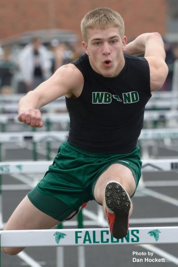 Photo by Dan Hockett West Burlington – Notre Dame JV's Grant Riley runs the 3rd leg of the Class-B 4x100-meter hurdle relay at the West Burlington Coed Relays Saturday in West Burlington. The JV team placed third in Class-B 4x100-meter hurdle relay.