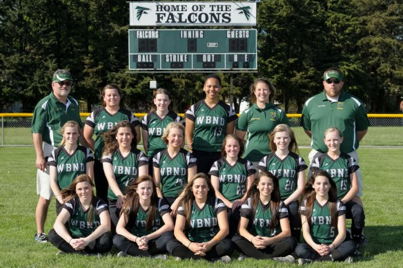 Arrangement  by National Studio, Photo by Dan Hockett WBND Varsity Softball Front row (l-r): Riley Hale, Kelci Hill, Brandall Diaz, Machaela Diaz, Courtney Coffin. Middle row (l-r): Olivia Krieger, Reagan Rogerson, Shayleigh Abbot, Reagan Olson. Back row (l-r): Coach David Oleson, Regan Fraise, Tara Goff, Alex Yacko, Asst. Coach Kaitlyn Caston, Asst. Coach Jason Yacko.