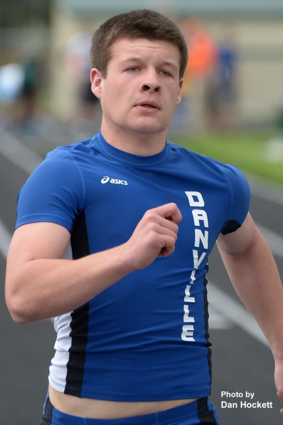 Photo by Dan Hockett Danville's Grant Samples places 4th in the 100-meter run with a time of 12.22 seconds during Monday's South Division Conference Meet in West Burlington.