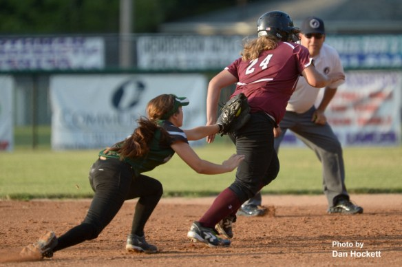 Photo by Dan Hockett West Burlington – Notre Dame Third Baseman Machaela Diaz (left) chases down Clarke's Kindred Amanda (24) for the out in the Region-6 Final Monday night in Ottumwa. West Burlington – Notre Dame fell to Clarke, 3-2.