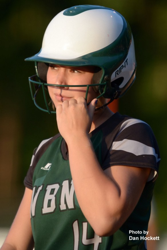 Photo by Dan Hockett West Burlington – Notre Dame Batter Reagan Rogerson looks to coach for the signal before stepping in the batter's box Monday night during the Region-6 Final in Ottumwa. West Burlington – Notre Dame fell to Clarke, 3-2.