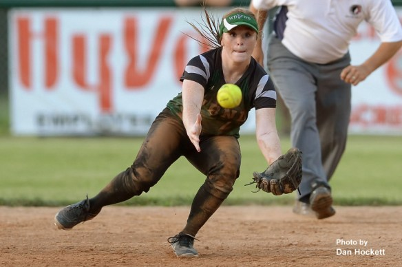 Photo by Dan Hockett West Burlington – Notre Dame Second Baseman Riley Hale tries to field a ball against Clarke in the Region-6 Final Monday night in Ottumwa. West Burlington – Notre Dame fell to Clarke, 3-2.