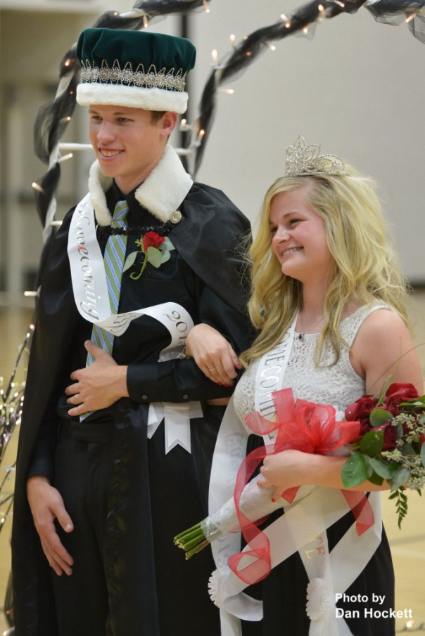 Photo by Dan Hockett West Burlington High School seniors Logan Reich (left) and Heidi Brown (right) are crowned Homecoming King and Queen at Thursday night's Pep Rally in West Burlington.