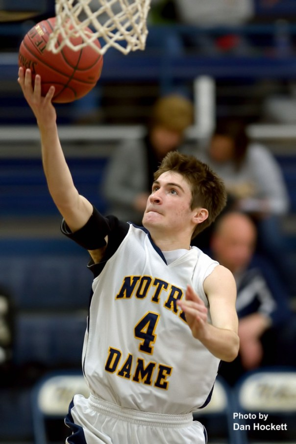 Photo by Dan Hockett Notre Dame's Cody Moehn takes the ball to the basket against Central Lee Thursday night at Father Minett Gymnasium in Burlington. Notre Dame defeated Central Lee, 58-45.