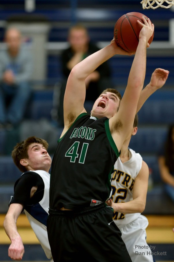 Photo by Dan Hockett West Burlington's Clay Siefken goes to the basket against Notre Dame Tuesday night at Father Minett Gymnasium in Burlington. Notre Dame defeated West Burlington, 62-46.