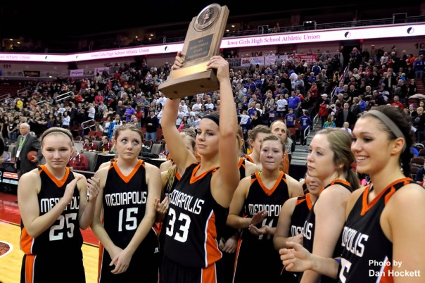 Photo by Dan Hockett Mediapolis senior Rachel Holsteen holds up '2014 State Semi-Finalist' trophy with her teammates after falling to MOC-Floyd Valley 64-51 Thursday in the Class-3A State Semifinal game at Wells Fargo Arena in Des Moines.
