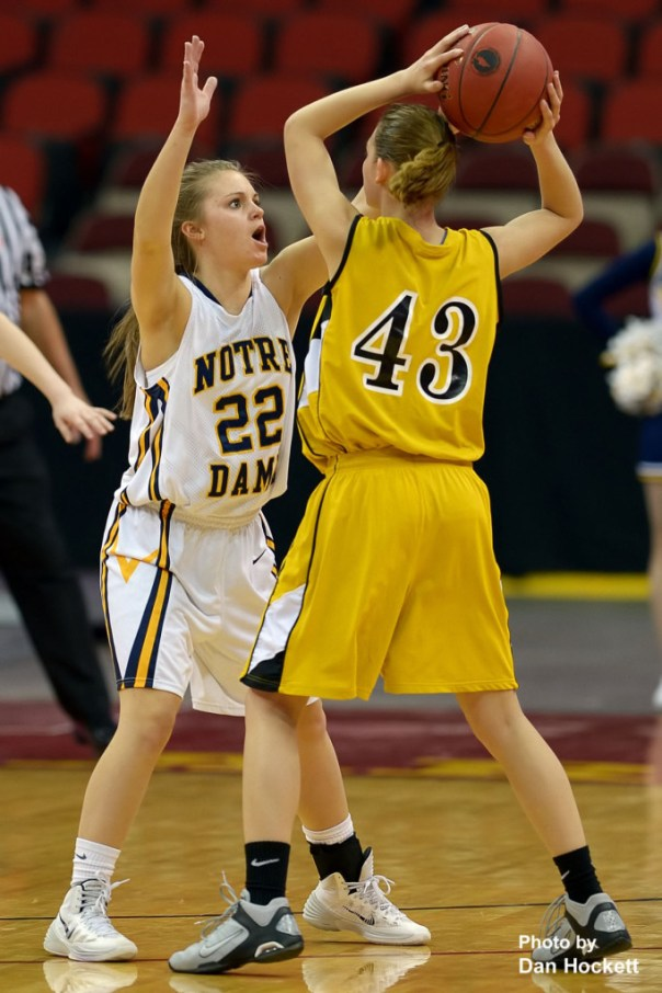 Photo by Dan Hockett Notre Dame's Courtney Abolt (22) guards Adair – Casey's Danni McCorkel (43) during the Class 1A State Quarterfinal Monday afternoon at Wells Fargo Arena in Des Moines. Notre Dame defeated Adair-Casey, 90-50.