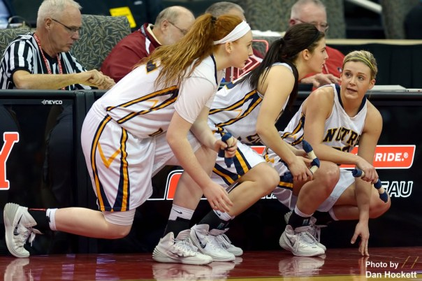Photo by Dan Hockett Notre Dame's (l-r): Emily Salvador, Riley Killbride, and Taylor Hickey prepare to go into the game during the Class 1A State Quarterfinal against Adair –Casey Monday afternoon at Wells Fargo Arena in Des Moines.
