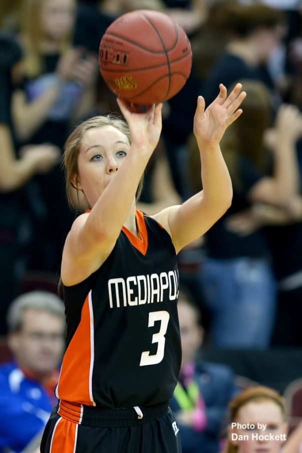 Photo by Dan Hockett Mediapolis' Darby Massner (3) shoots from beyond the arc against MOC-Floyd Valley Thursday in the Class-3A State Semifinal game at Wells Fargo Arena in Des Moines. Mediapolis fell to MOC-Floyd Valley, 64-51.