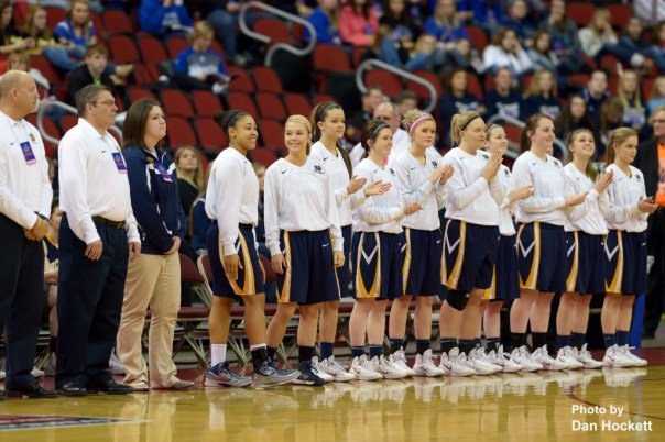 Photo by Dan Hockett Notre Dame Teammates are introduced before the Class 1A State Girls Championship game Friday night at Wells Fargo Arena in Des Moines