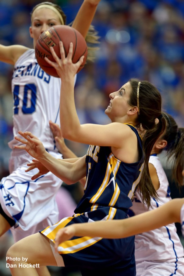 Photo by Dan Hockett Notre Dame's Courtney Coffin takes the ball to the net through Newell-Fonda defenders during the Class 1A State Girls Championship Friday night at Wells Fargo Arena in Des Moines. Notre Dame defeated Newell-Fonda, 57-54.