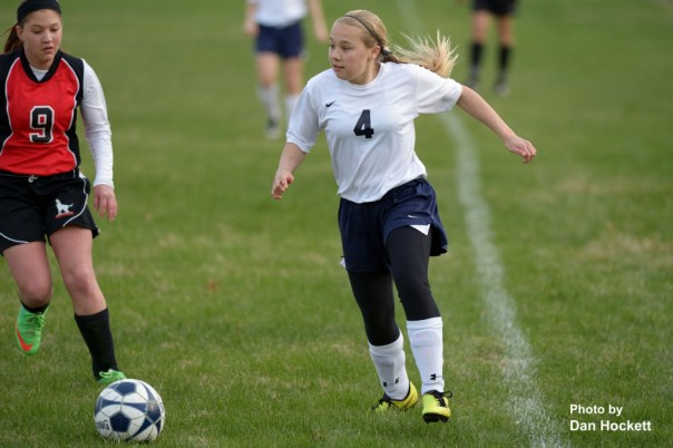 Photo by Dan Hockett Notre Dame – West Burlington – Danville's Christina Hunter looks to pass the ball toward Ft. Madison's goal Thursday in Burlington. NDWBD defeated Ft. Madison, 9-0.