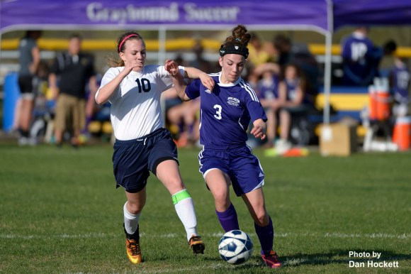 Photo by Dan Hockett Burlington's Elyse Huber (3) fights for the ball with Notre Dame – West Burlington – Danville's Claire Dupuis (10) Friday at Tackleson Field in Burlington. Burlington defeated NDWBD, 8-2.