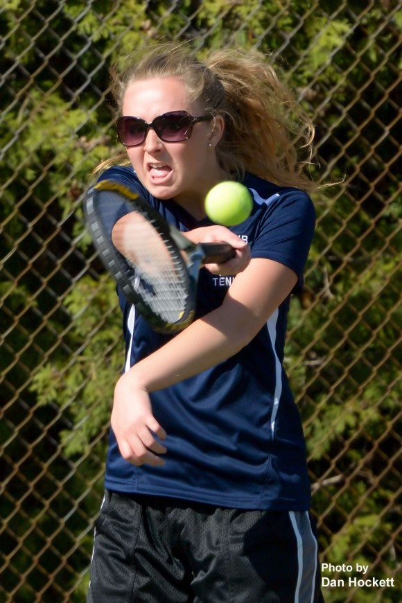Photo by Dan Hockett Notre Dame – West Burlington's Stephanie Wills returns the ball against Mt. Pleasant's Taylor Beatty Tuesday at Dankwardt Park in Burlington. Wills defeated Beatty, 8-1.