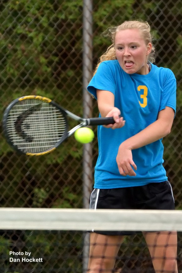 Photo by Dan Hockett Notre Dame – West Burlington's Stephanie Wills returns the ball against Fort Madison's Rachel Sugars Tuesday in Burlington.
