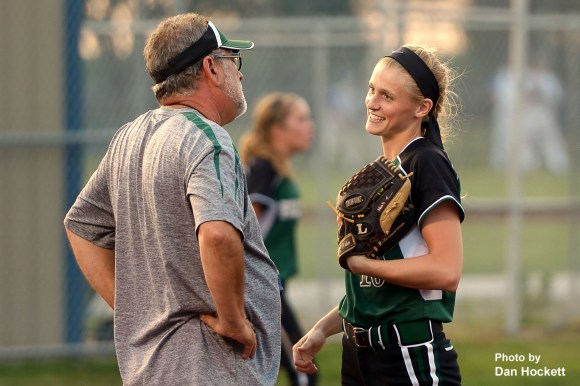 Photo by Dan Hockett West Burlington – Notre Dame Pitcher Kori  Mesecher enjoys a moment during a timeout with Head Coach David Oleson in their game against Danville Tuesday night in Danville. West Burlington – Notre Dame defeated Danville, 12-0, in 6-innings.