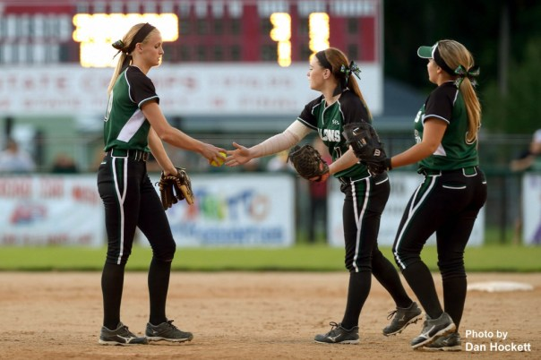 Photo by Dan Hockett West Burlington – Notre Dame Pitcher Kori Mesecher (left) is congratulated after a strikeout by Second Baseman Riley Hale (center) and First Baseman Brandall Diaz (right) during the Region-7 Final in Ottumwa Monday night. West Burlington – Notre Dame defeated PCM, 6-4.