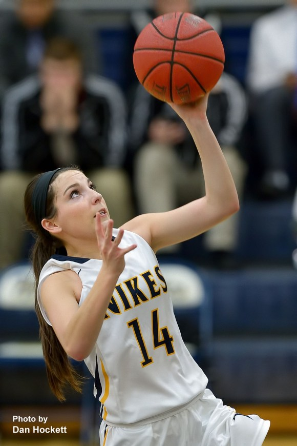 Photo by Dan Hockett Notre Dame's Courtney Coffin hits a layup against West Burlington Friday night in Burlington. Notre Dame defeated West Burlington, 100-38.