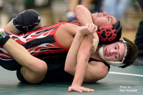 Photo by Dan Hockett WBNDD's Tristan Garcia (bottom) grapples with Cardinal's Andrew Martinez (top) in the 145lb match Thursday night in West Burlington. WBNDD's Garcia defeated Martinez, 10-1.