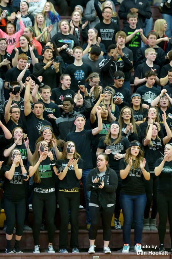 Photo by Dan Hockett West Burlington student section cheers for their team during the District-10 final in Mt. Pleasant Tuesday night. West Burlington defeated Highland, 45-44.