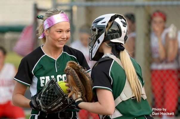 Photo by Dan Hockett West Burlington – Notre Dame Pitcher Reagan Rogerson (left) and Catcher Kelsi Hill (right) talk it over during Friday night's game against Highland in West Burlington. Highland defeated WBND, 4-2.