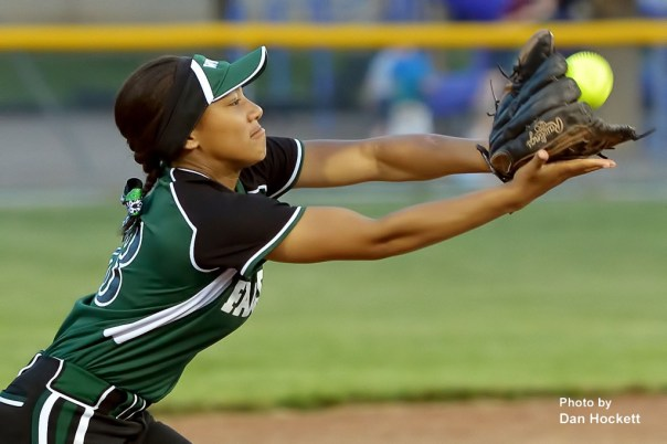 Photo by Dan Hockett West Burlington – Notre Dame Shortstop Jashira Baylark denies Highland's Kaytlin Chalupa a base hit in the sixth inning of Friday night's game in West Burlington. Highland defeated WBND, 4-2.