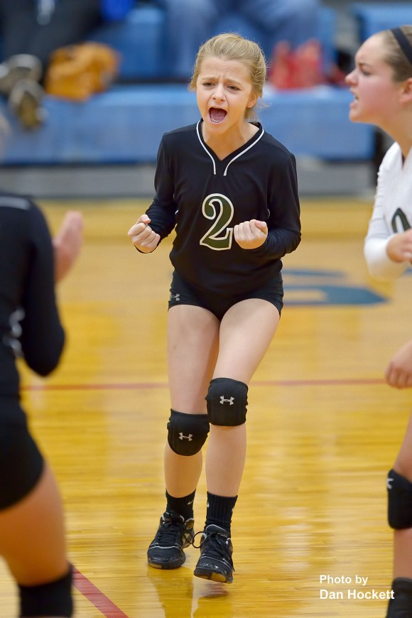 Photo by Dan Hockett West Burlington's McKenzie Fry (2) celebrates after winning a point against Notre Dame Saturday afternoon at Father Minnett Gymnasium in Burlington. Falcon placed 4th, with 3-3 record.