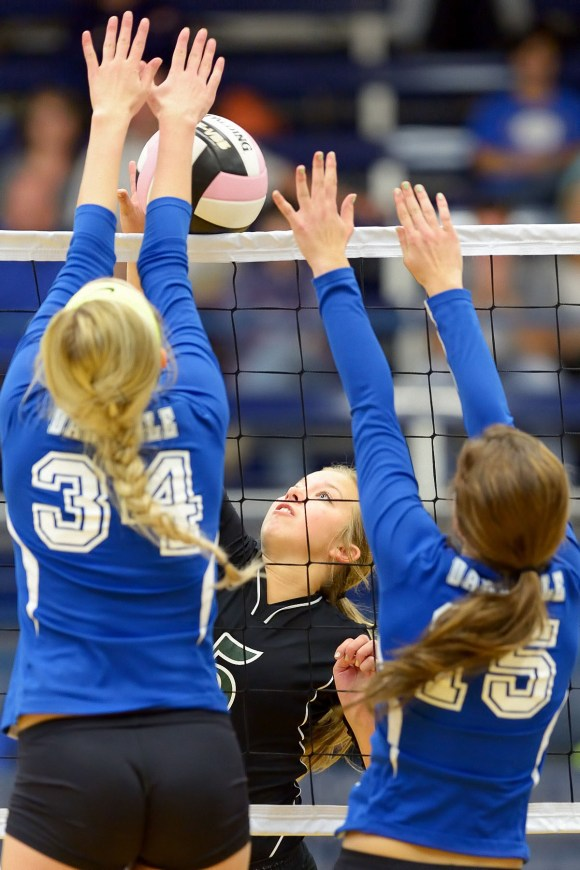 Photo by Dan Hockett West Burlington's Kamaryn Atwater (5) hits the ball between Danville defenders Emma Jarrett (34) and Grace Grathe (15) Saturday afternoon at Father Minnett Gymnasium in Burlington. Falcon placed 4th, with 3-3 record.