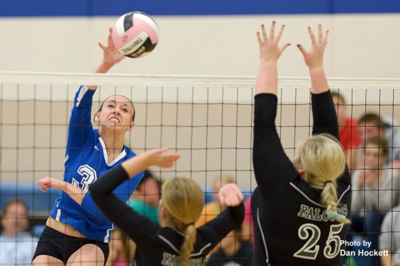 Photo by Dan Hockett Danville's Alexis Hite (left) sends the ball over net as West Burlington's Shaelyn Thomann (25) tries to block Tuesday night in Danville. West Burlington defeated Danville, 25-19, 52-22, 25-21.