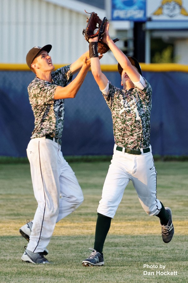 Photo by Dan Hockett West Burlington Centerfielder Daniel Crooks (1) catches the flyball with Leftfielder Colton Hohenthaner (left) backing him up Thursday night against Notre Dame in Burlington. Notre Dame defeated West Burlington, 3-1.