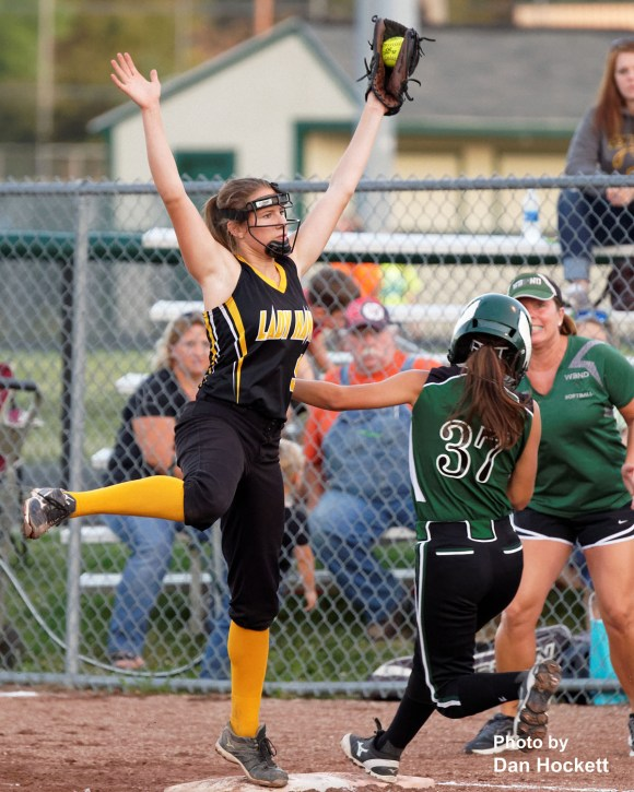 Photo by Dan Hockett Central Lee's Makenna Hall reaches for the force out at first on West Burlington – Notre Dame's Morgan Flowers (37) in Class 3A, Region-4 quarterfinal, Tuesday night in West Burlington. West Burlington – Notre Dame defeated Central Lee, 9-1.