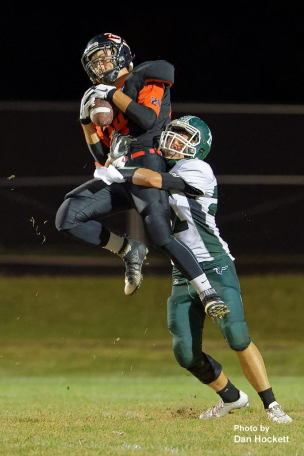 Photo by Dan Hockett Fairfield Wide Receiver Hunter Hoskins is tackled as he makes the catch by West Burlington – Notre Dame Defensive Back Jett Tjaden Friday night in Fairfield. West Burlington – Notre Dame defeated Fairfield, 20-13.