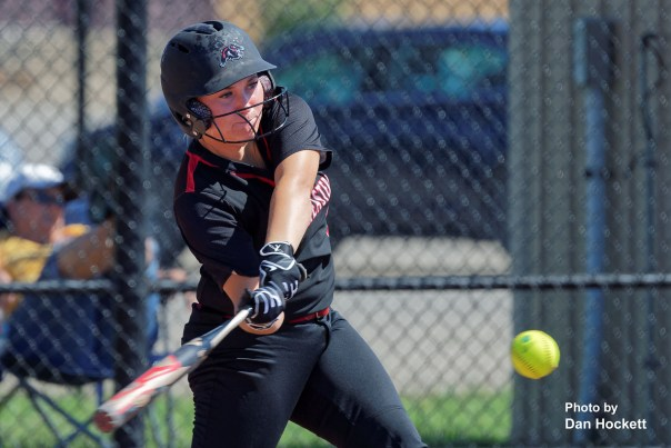 Photo by Dan Hockett SCC's Jorgi Krieger gets a hit against William Penn Sunday afternoon in West Burlington. Krieger is a former New London Softball Standout. SCC defeated William Penn in doubleheader, 11-4, 17-2.