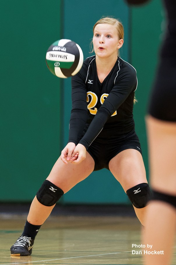 Photo by Dan Hockett New London's Kristen Rohdy (22) bumps the ball in to play against West Burlington Tuesday night in West Burlington. New London defeated West Burlington, 25-22, 25-15, 25-23.