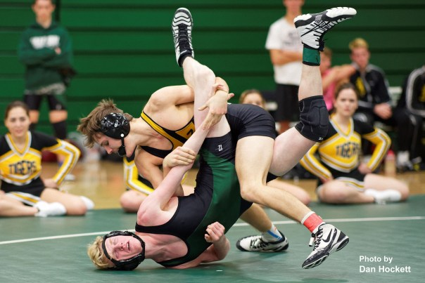 Photo by Dan Hockett New London 152-pounder Reno Chiri (top) puts Falcon Tucker Moore on the mat Thursday night in West Burlington. Chiri pinned Moore (5:11). New London defeated WBNDD, 68-6.