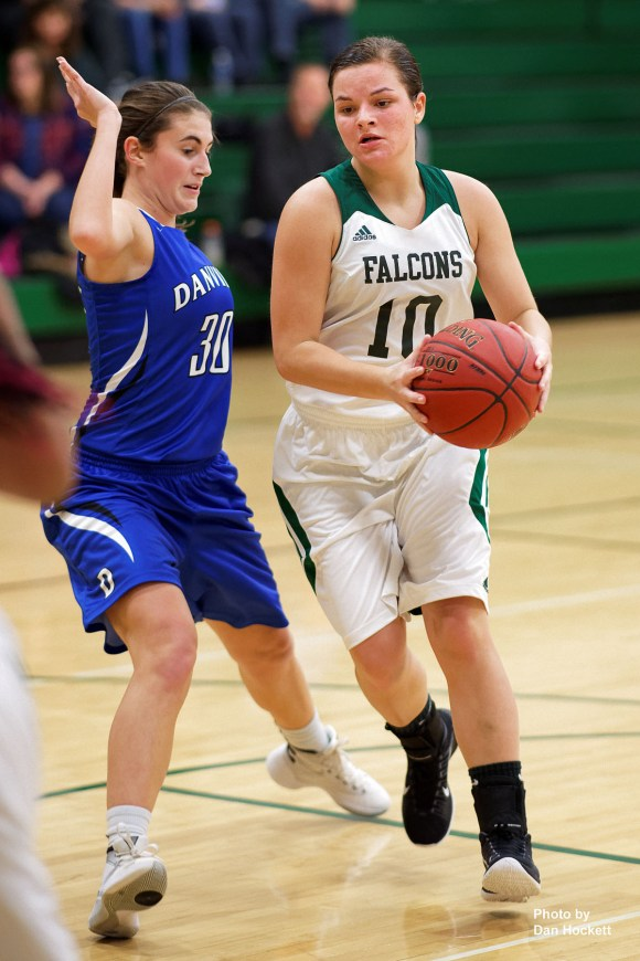 Photo by Dan Hockett West Burlington's Gaby Price (10) drives the lane while defended by Danville's Alexis Bauer (30) Friday night in West Burlington. Danville defeated West Burlington, 46-33.