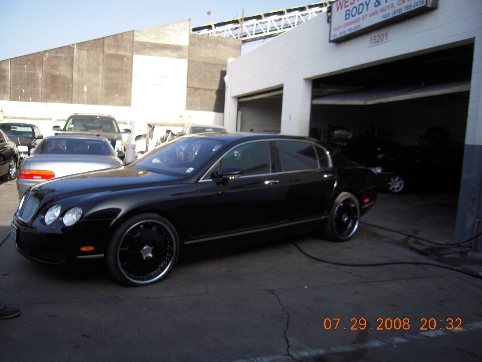west-coast-body-and-paint-black-bentley-3