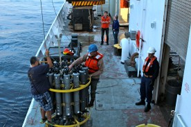 Working on the CTD, getting it ready for deployment. Photo credit: Melissa Ward